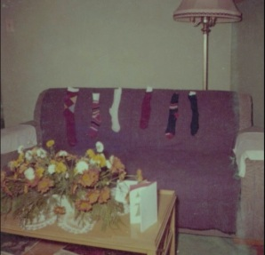 Picture of sofa with six stocking lined up for Santa