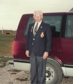 Picture of my dad standing in front of his vehicle in his Legion Jacket